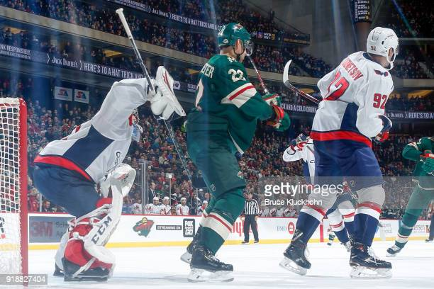 Philipp Grubauer and Evgeny Kuznetsov of the Edmonton Oilers defend their goal against Nino Niederreiter of the Minnesota Wild during the game at the...