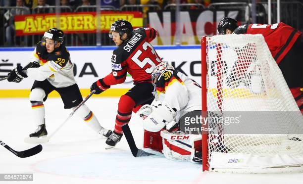 Philipp Grubauer of Germany is challenegd by Jeff Skinner of Canada during the 2017 IIHF Ice Hockey World Championship Quarter Final game between...