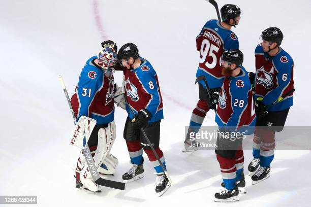 Philipp Grubauer of the Colorado Avalanche celebrates with Cale Makar after defeating the Arizona Coyotes in Game One of the Western Conference First...