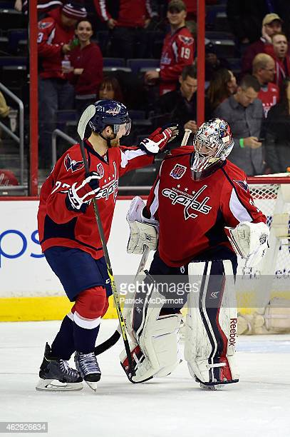 Philipp Grubauer of the Washington Capitals celebrates with his teammate Karl Alzner after the Capitals defeated the Anaheim Ducks 32 in a shootout...