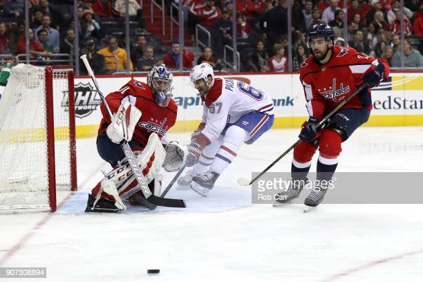 Philipp Grubauer of the Washington Capitals deflects a shot by Max Pacioretty of the Montreal Canadiens in the third period at Capital One Arena on...