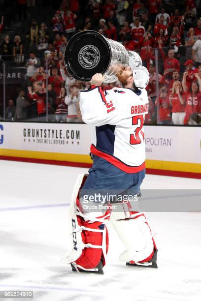Philipp Grubauer of the Washington Capitals hoists the Stanley Cup after his team defeated the Vegas Golden Knights 43 in Game Five of the 2018 NHL...