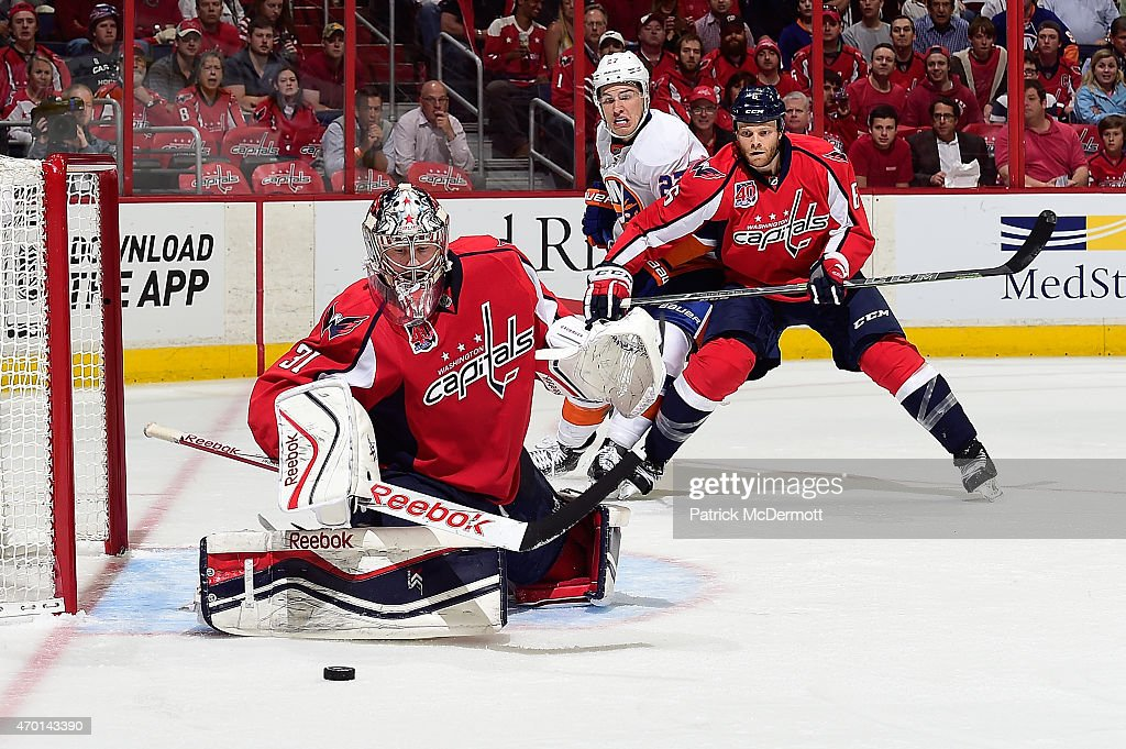 Philipp Grubauer #31 of the Washington Capitals makes a save during the first period against the New York Islanders in Game Two of the Eastern Conference Quarterfinals during the 2015 NHL Stanley Cup Playoffs at Verizon Center on April 17, 2015 in Washington, DC.
