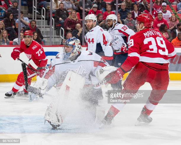 Philipp Grubauer of the Washington Capitals reacts to a shot as Anthony Mantha of the Detroit Red Wings stops in front during an NHL game at Little...