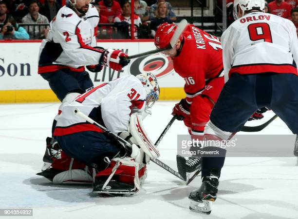 Philipp Grubauer of the Washington Capitals smothers a scoring attempt from Marcus Kruger of the Carolina Hurricanes during an NHL game on January 12...