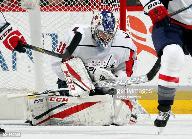 Philipp Grubauer of the Washington Capitals swallows a Carolina Hurricanes shot during an NHL game on January 12 2018 at PNC Arena in Raleigh North...