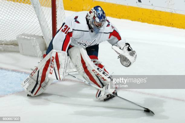 Philipp Grubauer of the Washington Capitols handles the puck during a NHL game against the San Jose Sharks at SAP Center on March 10 2018 in San Jose...