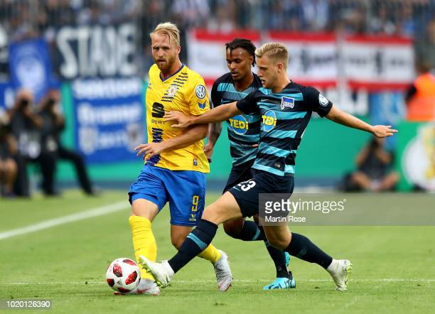 Philipp Hofmann of Braunschweig and Arne Maier of Berlin battle for the ball during the DFB Cup first round match between Eintracht Braunschweig and...
