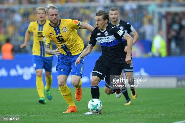 Philipp Hofmann of Braunschweig and Konstantin Kerschbaumer of#bi00 fight for the ball during the Second Bundesliga match between Eintracht...