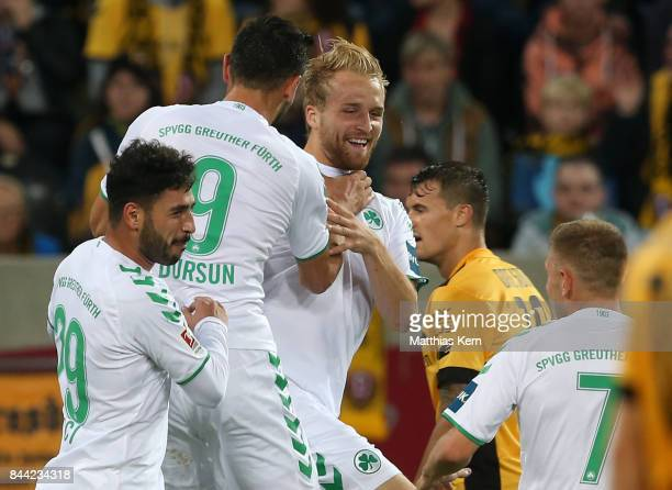 Philipp Hofmann of Fuerth jubilates with team mates after scoring the second goal during the Second Bundesliga match between SG Dynamo Dresden and...