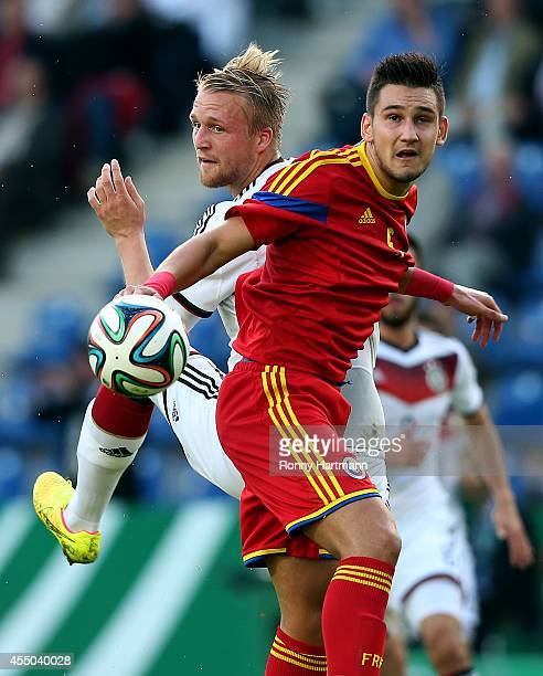 Philipp Hofmann of Germany and Deian Boldor of Romania head for the ball during the U21 Germany v U21 Romania 2015 UEFA European U21 Championships...