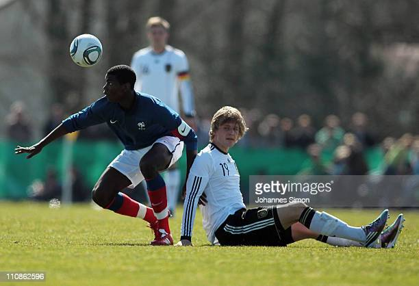 Philipp Hofmann of Germany and Paul Pogba of France compete for the ball during the U18 international friendly match between Germany and France at...