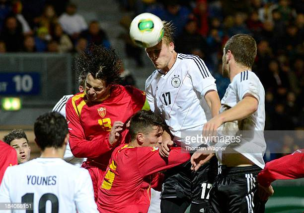 Philipp Hofmann of Germany heads the ball during the U21 Euro qualifier group 6 match between Germany and Republic of Montenegro at Brita Arena on...