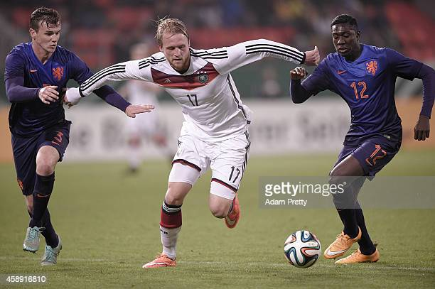 Philipp Hofmann of Germany is challenged by Peet Bijen of the Netherlands during the U21 Germany v U21 Netherlands International Friendly match at...