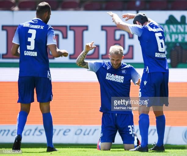 Philipp Hofmann of Karlsruhe celebrates his team's first goal with team mates during the Second Bundesliga match between Karlsruher SC and SV...