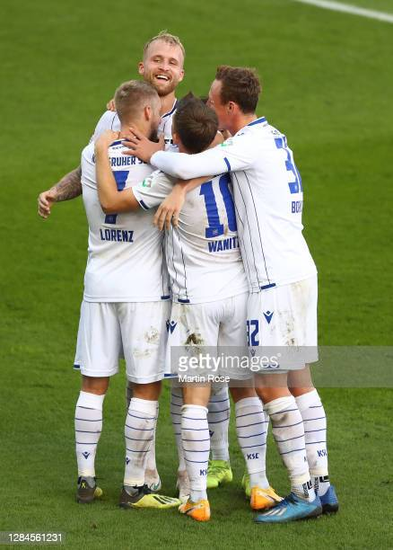 Philipp Hofmann of Karlsruhe celebrates with team mates after scoring his teams third goal during the Second Bundesliga match between FC St. Pauli...