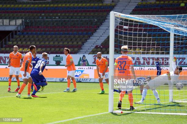Philipp Hofmann of Karlsruhe scores his team's first goal during the Second Bundesliga match between Karlsruher SC and SV Darmstadt 98 at...