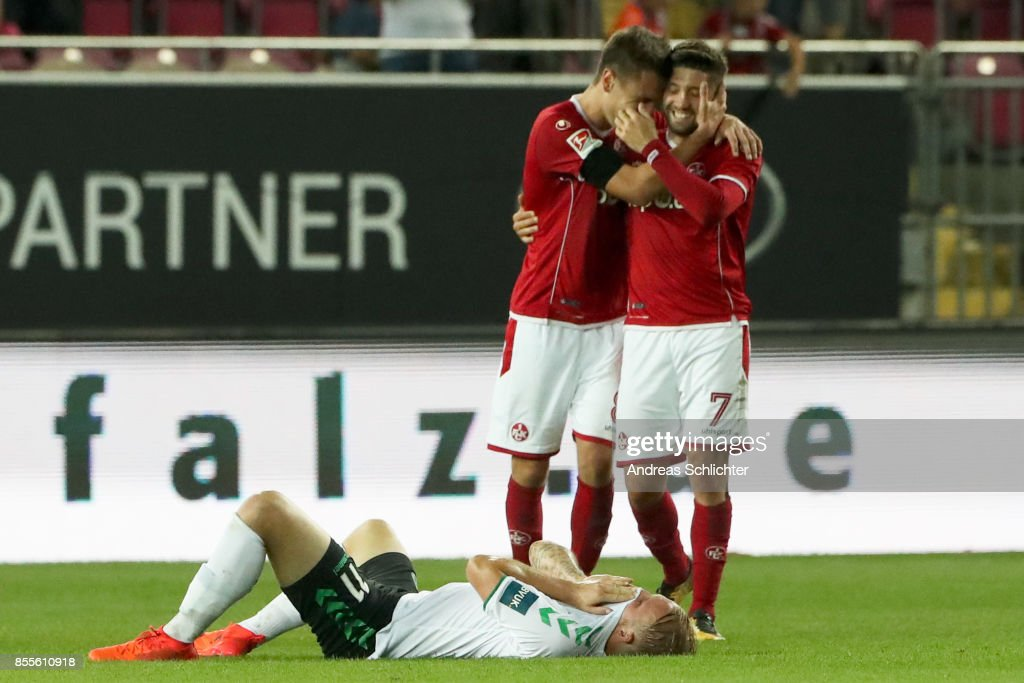 Philipp Hofmann of SpVgg Greuther Fuerth and Gino Fechner , Brandon Borrello of 1.FC Kaiserslautern during the Second Bundesliga match between 1. FC Kaiserslautern and SpVgg Greuther Fuerth at Fritz-Walter-Stadion on September 29, 2017 in Kaiserslautern, Germany.