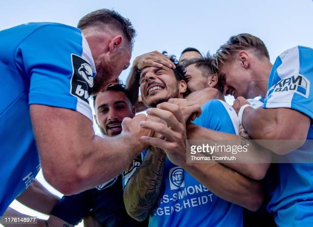 Philipp Hosiner of Chemnitz celebrates with teammates after scoring the game winning goal during the 3 Liga match between Chemnitzer FC and FC Carl...