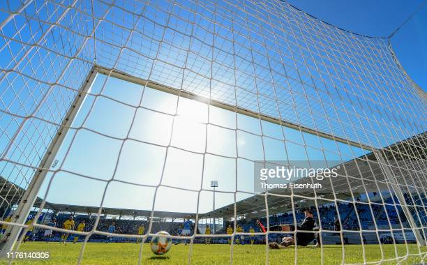 Philipp Hosiner of Chemnitz scores his team's first goal with a penalty past goalkeeper Joshua Mross of Jena during the 3. Liga match between...