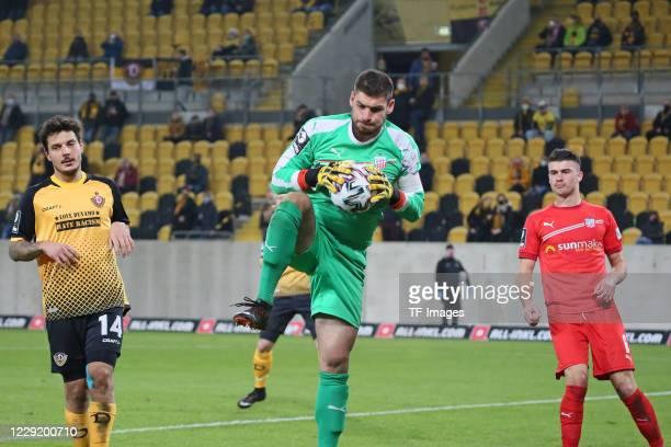 Philipp Hosiner of SG Dynamo Dresden and goalkeeper Johannes Brinkies of FSV Zwickau and Jozo Stanic of FSV Zwickau battle for the ball during the 3...