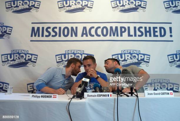 Philipp Huemmer Romain Espino and JeanDavid Cattin members of antimigrant group Defend Europe hold a press conference following the return of the...