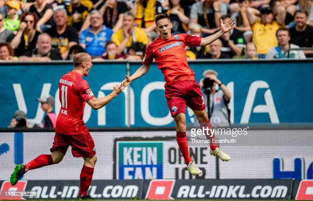 Philipp Klement of Paderborn celebrates with Sven Michel after his team's first goal during the Second Bundesliga match between SG Dynamo Dresden and...