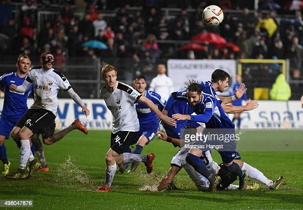 Philipp Klingmann of Sandhausen, Jan Mauersberger of Karlsruhe, Aziz Bouhaddouz of Sandhausen and Martin Stoll of Karlsruhe compete for the ball...