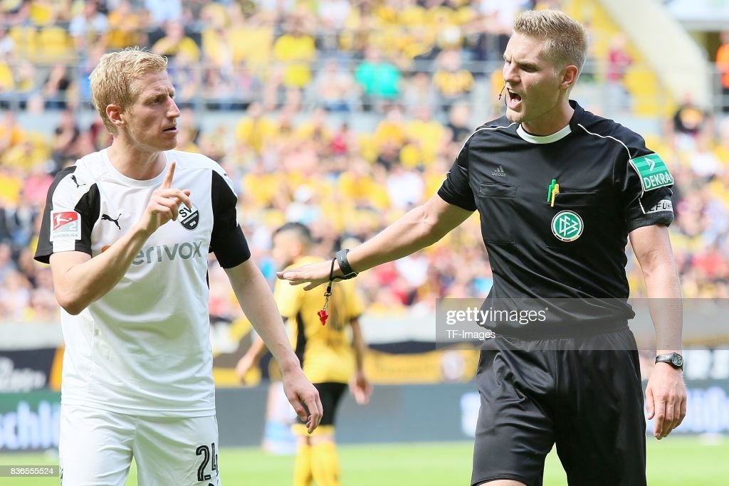 Philipp Klingmann of Sandhausen speak with Timo Gerach during the Second Bundesliga match between Dynamo Dresden and SV Sandhausen at DDV-Stadion on August 19, 2017 in Dresden, Germany.