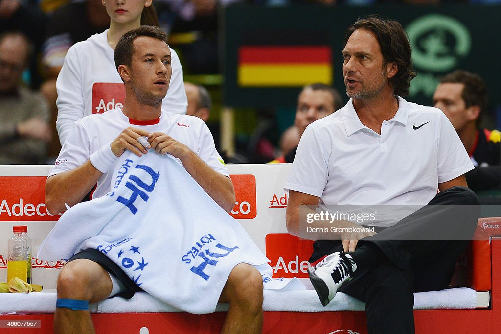 Philipp Kohlschreiber of Germany and head coach Carsten Arriens react on day 1 of the Davis Cup First Round match between Germany and Spain at Fraport Arena on January 31, 2014 in Frankfurt am Main, Germany.
