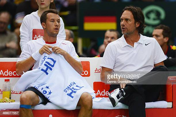 Philipp Kohlschreiber of Germany and head coach Carsten Arriens react on day 1 of the Davis Cup First Round match between Germany and Spain at...