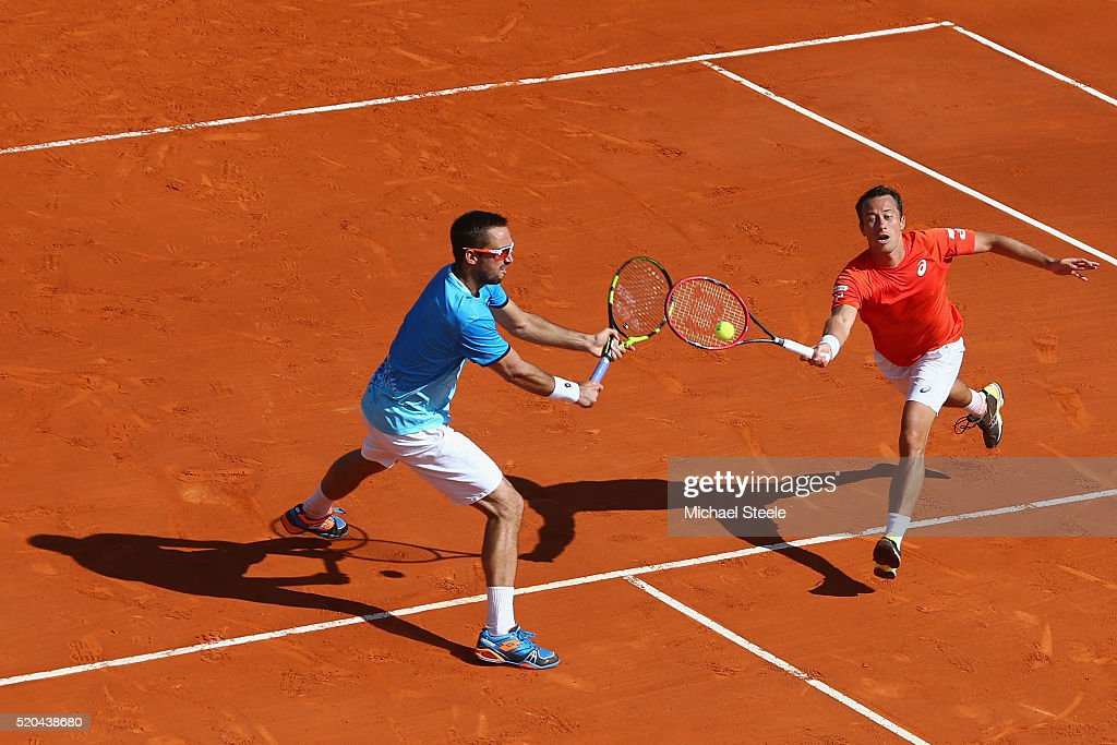 Philipp Kohlschreiber (R) of Germany and Viktor Troicki (L) of Serbia hit a return against Fernando Verdasco and Rafael Nadal of Spain during day two of the Monte Carlo Rolex Masters at Monte-Carlo Sporting Club on April 11, 2016 in Monte-Carlo, Monaco.