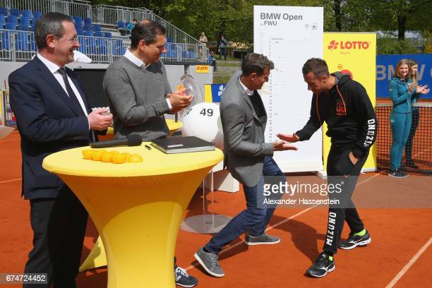 Philipp Kohlschreiber of Germany attends with Tournament Director Patrick Kuehnen the draw for the 102 on April 29 2017 in Munich Germany BMW Open by...