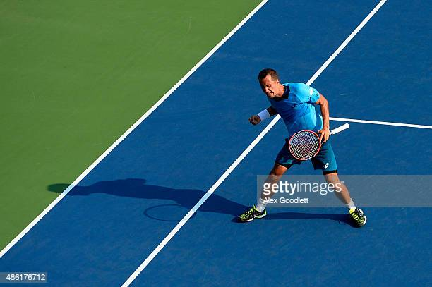 Philipp Kohlschreiber of Germany celebrates after defeating Alexander Zverev of Germany during their Men's Singles First Round match on Day Two of...