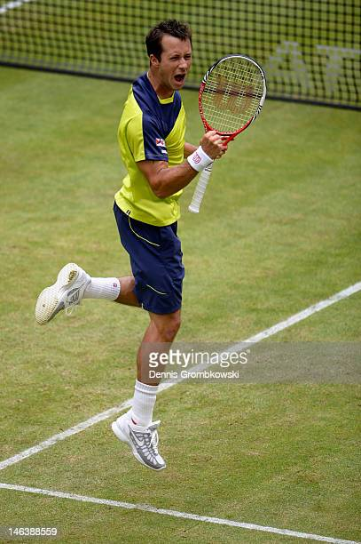 Philipp Kohlschreiber of Germany celebrates after winning his quarterfinal match against Rafael Nadal of Spain during day five of the Gerry Weber...
