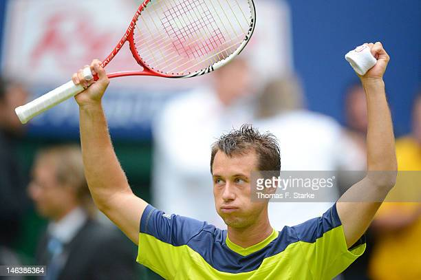 Philipp Kohlschreiber of Germany celebrates after winning his quarter final match against Rafael Nadal of Spain during day five of the Gerry Weber...