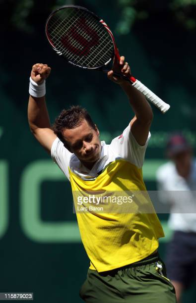 Philipp Kohlschreiber of Germany celebrates after winning his semi final match against Gael Monfils of France during day 6 of the Gerry Weber Open at...