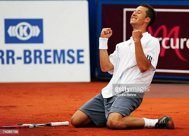 Philipp Kohlschreiber of Germany celebrates after winning the final against Mikhail Youzhny of Russia during the BMW Open at the Iphitos tennis club...