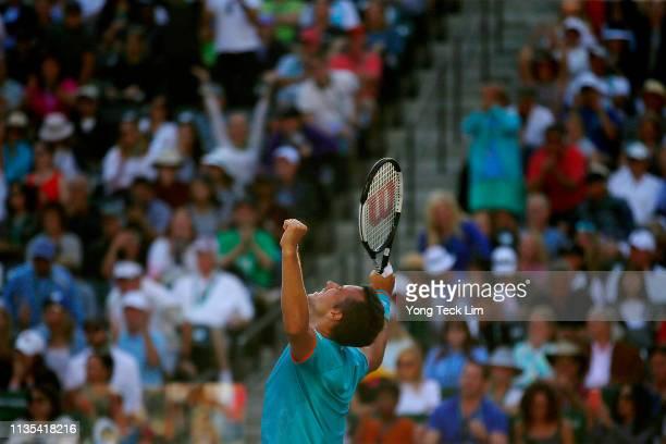 Philipp Kohlschreiber of Germany celebrates his men's singles third round match victory against Novak Djokovic of Serbia on Day 9 of the BNP Paribas...