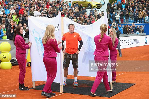 Philipp Kohlschreiber of Germany celebrates in the winners present a tradiitional Bavarian Lederhosen after winning his finale match against Dominic...