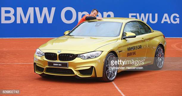 Philipp Kohlschreiber of Germany celebrates in the winners present a BMW M4 Cabrio after winning his finale match against Dominic Thiem of Austria of...