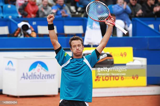 Philipp Kohlschreiber of Germany celebrates victory after winning his final match against Marino Cilic of Croatia at BMW Open at Iphitos tennis club...