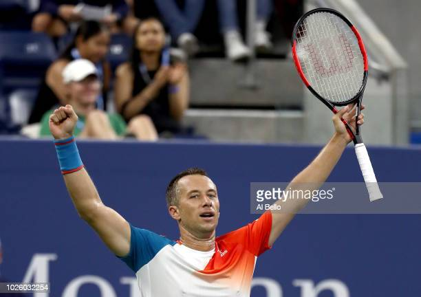 Philipp Kohlschreiber of Germany celebrates victory in his men's singles third round math against Alexander Zverev of Germany on Day Six of the 2018...