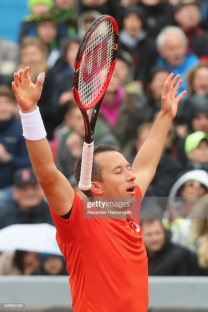 Philipp Kohlschreiber of Germany celebrates winning his finale match against Dominic Thiem of Austria of the BMW Open at Iphitos tennis club on May 1, 2016 in Munich, Germany.