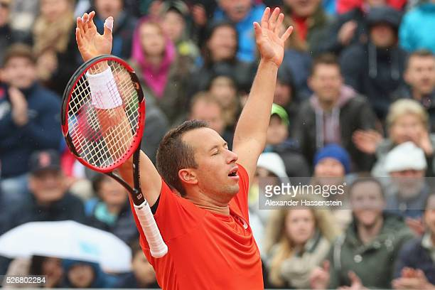 Philipp Kohlschreiber of Germany celebrates winning his finale match against Dominic Thiem of Austria of the BMW Open at Iphitos tennis club on May...