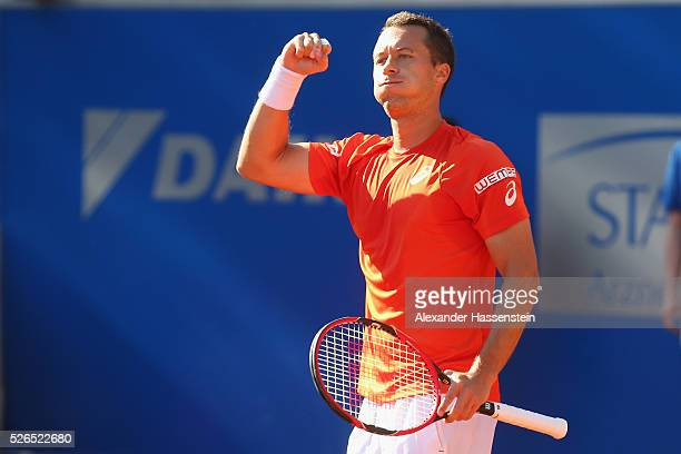 Philipp Kohlschreiber of Germany celebrates winning his semi finale match against Fabio Fognini of Itlay of the BMW Open at Iphitos tennis club on...
