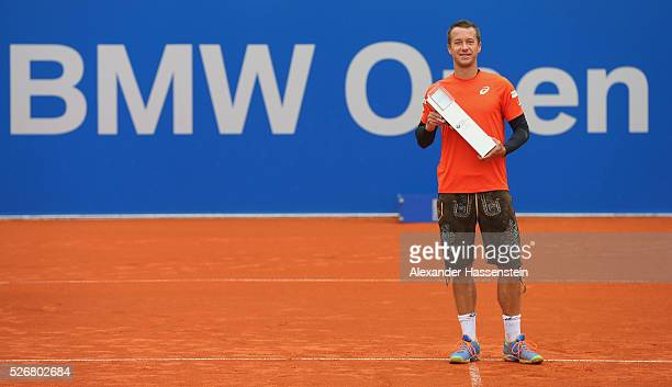 Philipp Kohlschreiber of Germany celebrates with the winners trophy for the BMW Open by FWU 2016 after winning his finale match against Dominic Thiem...