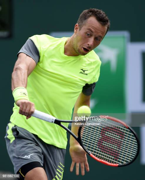 Philipp Kohlschreiber of Germany hits a backhand against Marin Cilic of Croatia during Day 9 of BNP Paribas Open on March 13 2018 in Indian Wells...