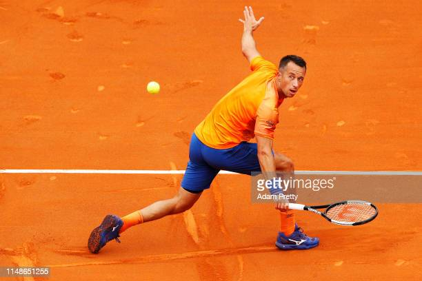 Philipp Kohlschreiber of Germany hits a backhand to Simon Gilles of France on day 1 of the Internazionali BNL d'Italia at Foro Italico on May 12,...