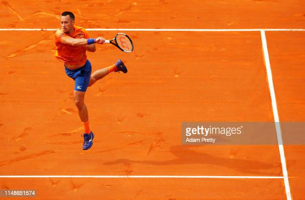 Philipp Kohlschreiber of Germany hits a forehand to Simon Gilles of France on day 1 of the Internazionali BNL d'Italia at Foro Italico on May 12,...